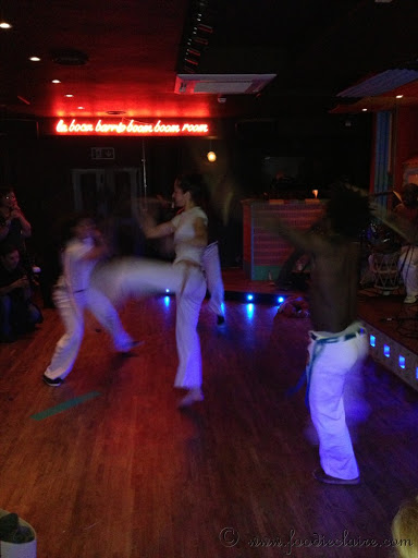 capoeira dancers at barrio east