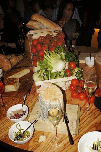 More cheese, vegetables and bread - can you spy someone in the background?